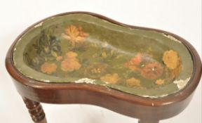 An 18th / 19th century regency mahogany kidney shaped bidet