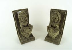 Pair of cast stone bookends