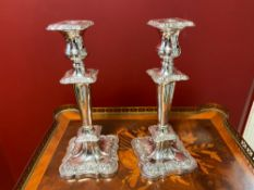 Pair of silver Victorian candlesticks
