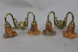 Pair of Two Arm Brass Wall Lights with Amber Shades