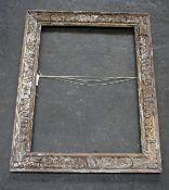 A large carved oak frame possibly Indian