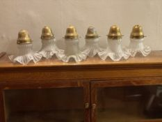 Six Edwardian glass shades with brass holders
