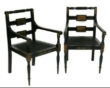 A pair of Regency style ebonised and painted carver chairs