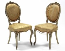A pair of 19th century French cream & gilt painted salon chairs
