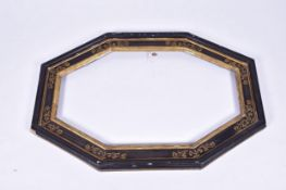 An ebonised and gilt decorated wooden framewith canted corners