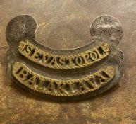 Silver hallmarked backed Crimean war military badge with the words Sebastopol and balaclava i