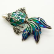 A silver plique-à-jour flying fish brooch set with a cultured pearl and marcasite stones.