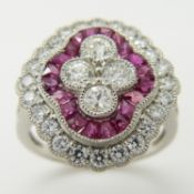 A large and stylish quatrefoil-shaped platinum ruby and old-cut diamond cocktail ring.