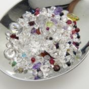 An assortment of over 100 unmounted stones totalling 95.10 carats.