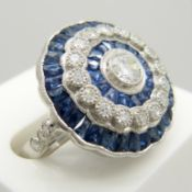 A large platinum floral-style diamond and sapphire cocktail ring.