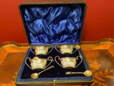 Set Of Four Boat Shape Silver Salts With Looped Handles And Four Silver Spoons.