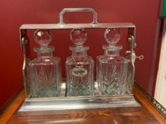 Silver-plated tantalus with three cut crystal decanters