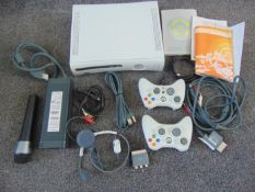 X box 360 comes with power unit loads of leads 2 hand controllers etc,