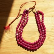 A necklace strung with 3 strands of oval faceted earth mined rubies, 927.50 carats