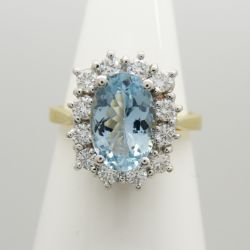 A sparkling 18ct white and yellow gold aquamarine and diamond cluster ring
