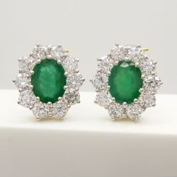 Stunning pair of 18ct yellow gold 3.60ct emerald and 3.00ct diamond cluster earrings