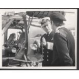 Royalty The Duke of Edinburgh discusses the finer points of flying with the pilot of the Wasp Helico