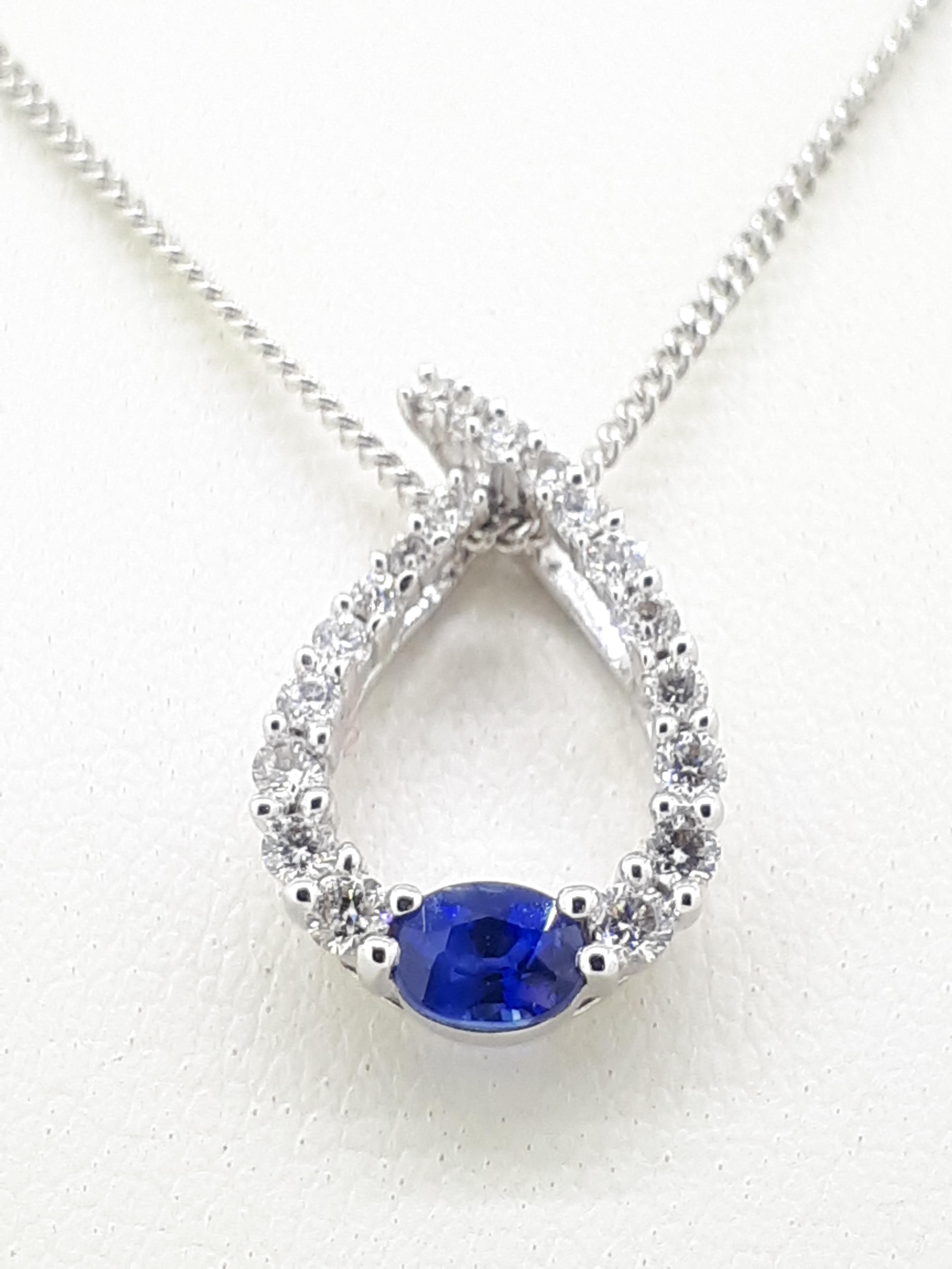 "18ct (750) White Gold Open 0.32ct Sapphire & 0.24ct Diamond Pendant on Curb Chain - 18"""