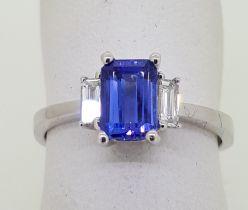 18ct (750) White Gold Emerald Cut Tanzanite and Diamond Ring