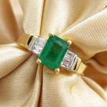 An 18ct yellow gold emerald-cut emerald ring set with baguette-cut diamond shoulders