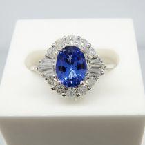 A stylish 18ct white gold tanzanite and diamond cluster ring