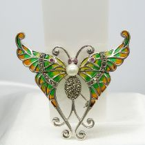 A large silver plique-à-jour butterfly brooch / pendant with a pearl, rubies and marcasites
