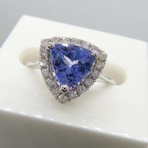 A superb 1.88ct trilliant-cut tanzanite and diamond halo dress ring in 18ct white gold