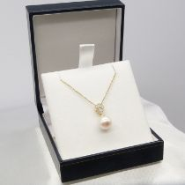 A classic cultured pearl and diamond bale necklace in 9ct yellow gold, boxed