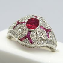 A platinum Victorian-style ruby and diamond ring in a filigree-style mount