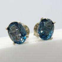 Oval-cut London blue topaz ear studs in silver