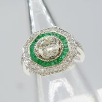 An Art Deco-inspired 14ct white gold 1.33ct diamond and 0.40ct emerald target ring with certificate