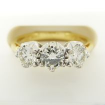 A certificated 0.95 carat diamond trilogy ring in 18ct white and yellow gold
