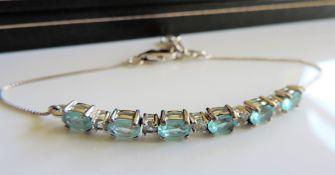 Blue and White Topaz Bracelet in Sterling Silver