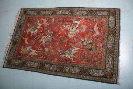 Seidenteppich (wohl aus Indien), mit Jagdmotiven, ca. 166 x 107,5 cm. Minimale Gebrauchsspuren.