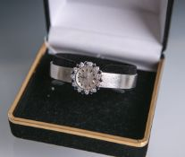"""Elegante Damenarmbanduhr """"Exquisit"""" 750 WG (1950/60er Jahre), Handaufzug, Lünette besetzt m. 11"""