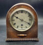 An Oak Kendal & Dent Mantle clock