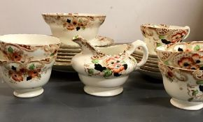 A floral part tea set consisting of tea cups and saucers, side plates etc