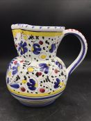 An hand painted vintage Deruta pitcher