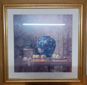 A large print depicting a Still life with a blue chinese vase and fruits, gilded framed and
