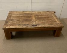 An oak coffee table made in Mexico, possibly made from an old door (H45cm W160cm D88cm)