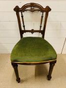 A William IV Style dining chair with carved mid side rails upholstered seat on reeded turned legs