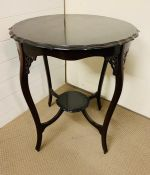A Mahogany side table or center table with pierced lattice work to frieze Diameter 62 cm x Height 73