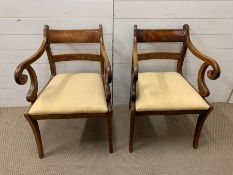 Two Mahogany chairs and two mahogany carvers.