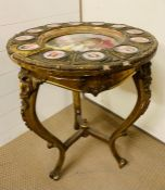 A Vienna style Gilt Gueridon salon table, inset with a porcelain plate to centre of The Duchess of