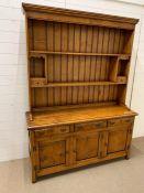 An Stewart Linford burr oak dresser with plate rack and cupboard under(H200cm W148cm D47cm)