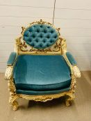 A Louis XV Style armchair/throne. The chair frame is decorated with foliate and scroll carving,