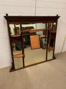 An over the mantle mahogany mirror (135cm x 140cm)