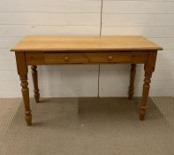 A Pine side table (H77cm W121cm D50cm)