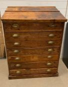 A pine seven drawer Clarks desk with brass shell style handles (H115cm W85cm D54cm)