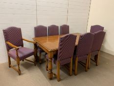 An Stewart Linford burr oak dining suite consisting of table, six chairs and two carvers by